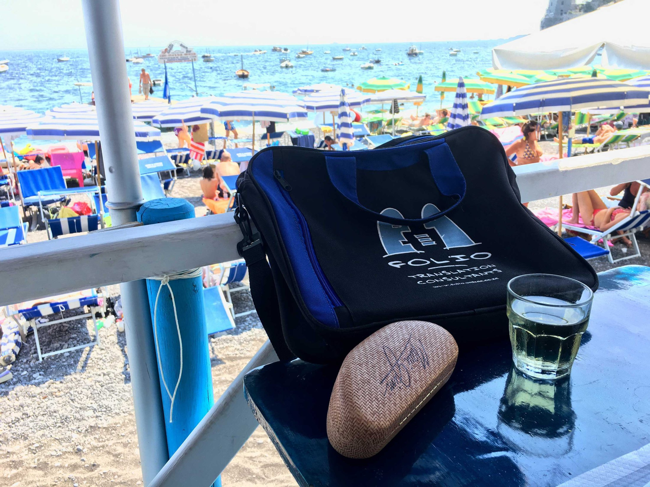 La dolce vita. Bag having a drink at the beach in Positano, Italy. July 2017.