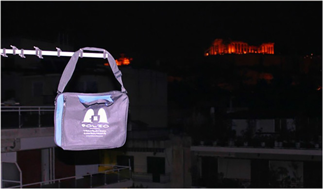 Bag and the Acropolis at night. Athens, Greece, April 2014.