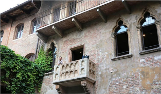 Bag and Juliet on the balcony of the Casa di Giulietta in Verona. Italy, May 2015.