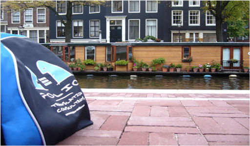 Bag admiring a houseboat on an Amsterdam gracht. Holland, October 2012.