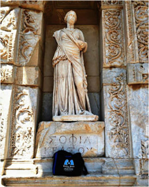 Bag under the statue of Sophia (Wisdom) in the facade of the Roman Library of Celsus, Ephesus, Turkey,  July 2014.