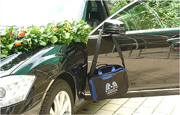 Attending a wedding in Stuttgart, Germany, Bag is pressed into service as driver of the wedding car. June 2012.