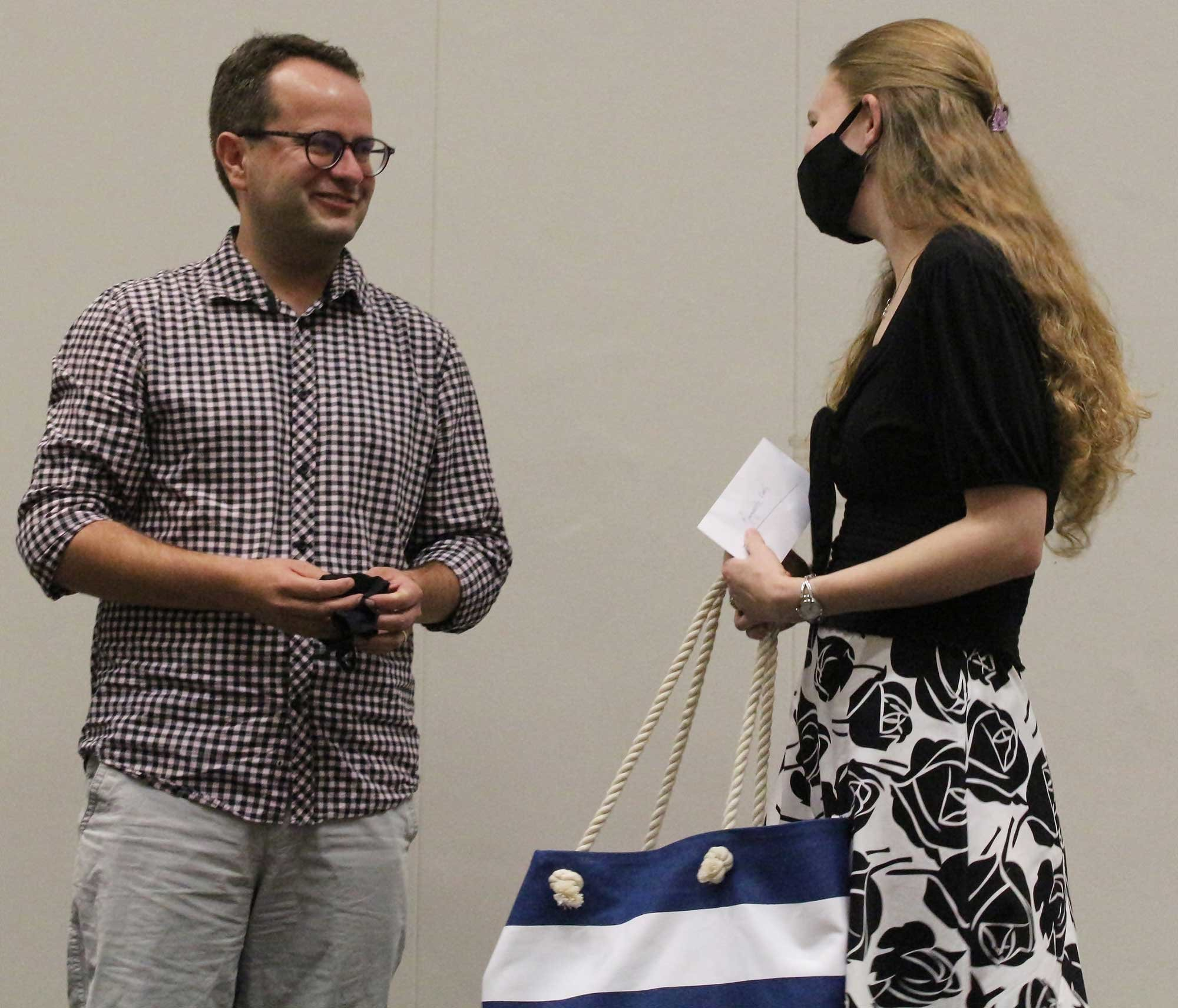 Marguerite Ewert receives the Folio Prize for best student in the Honours Degree in Translation at the University of Stellenbosch from Johan Botha.