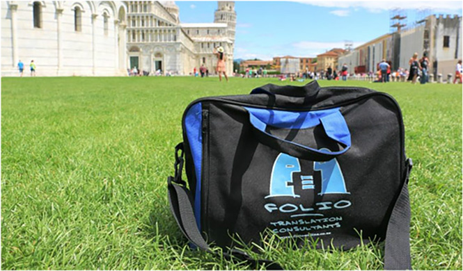 Bag admiring the famous Baptistry, Duomo and Leaning Tower of Pisa. Italy, May 2015.