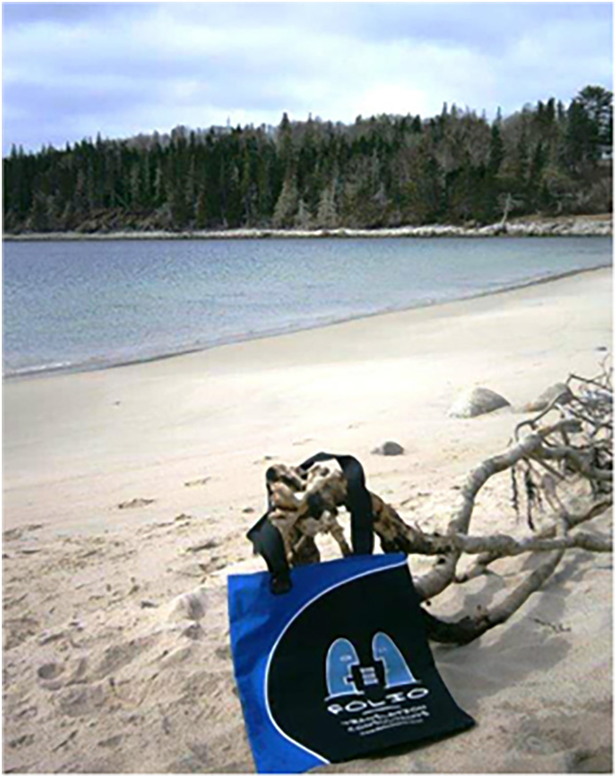 More chilling than tanning, Bag enjoying Queen's Beach, Nova Scotia, Canada, May 2015.