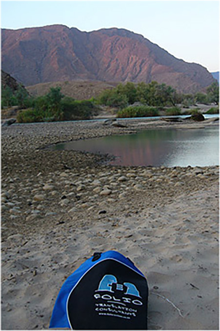 After a long day's trek, Bag relaxes on the banks of the Kunene River, Namibia,  June 2013.