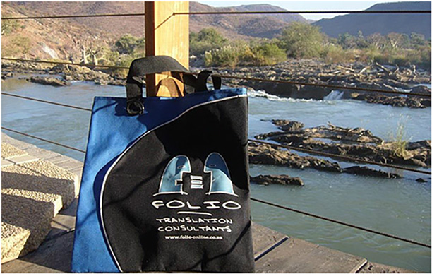 Bag at the Epupa Falls in the Kunene River, with Angola in the background. Namibia, June 2013.