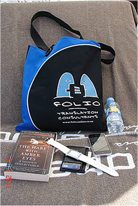 Bag and beach essentials chilling at trendy Purobeach Club.