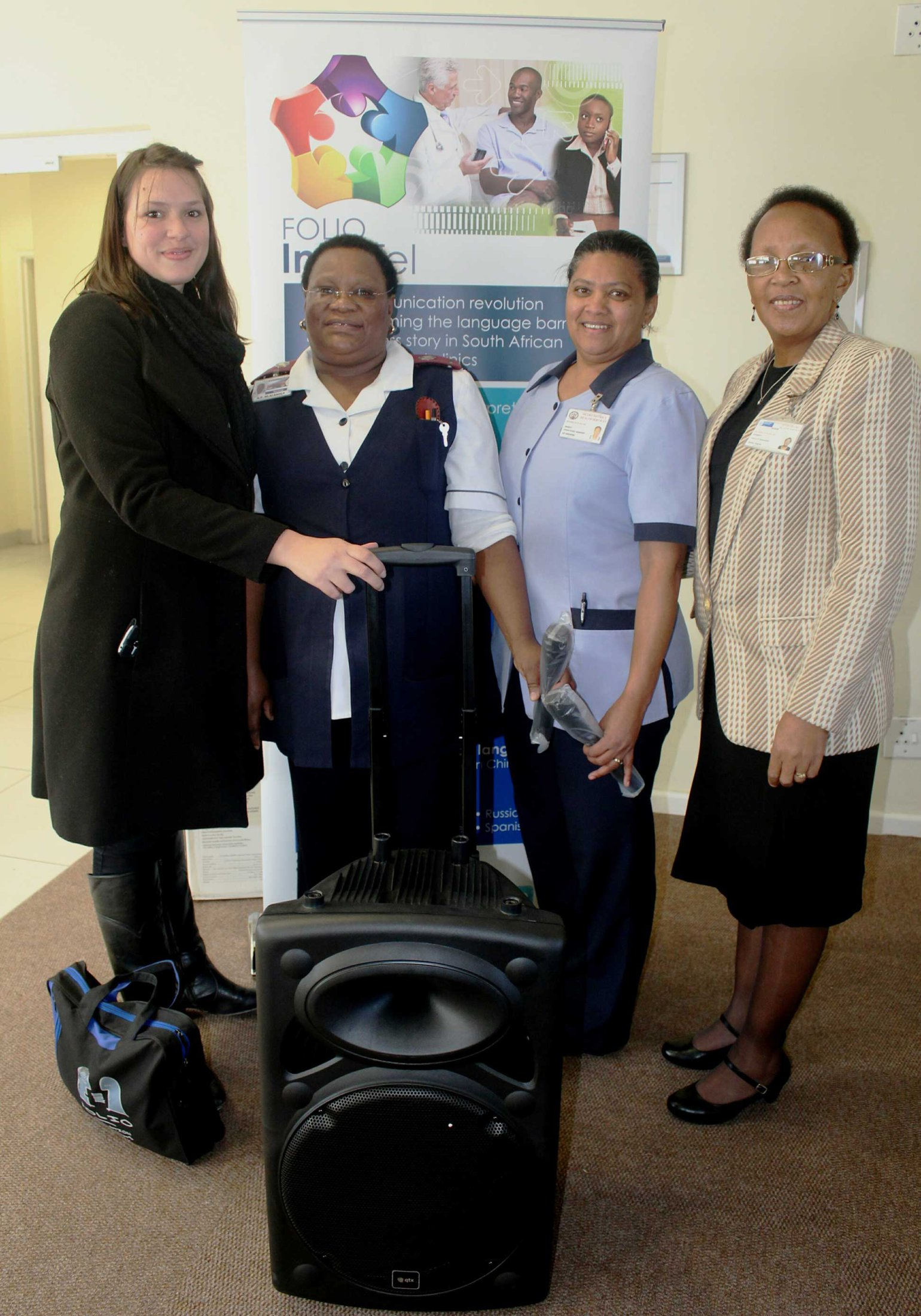 Staff members of Mitchells Plain CHC with their prize, a portable PA system with cordless microphones, presented to them by Folio InterTel's Lauri King. 23.06 16.