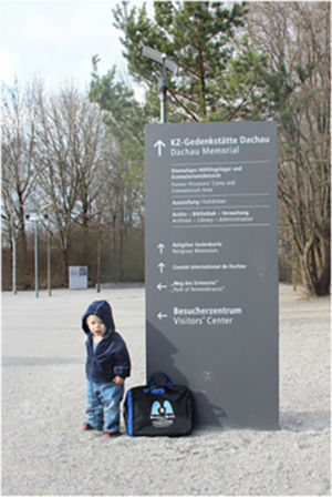 Bag & little friend at the entrance to Dachau concentration camp outside Munich, March 2014.