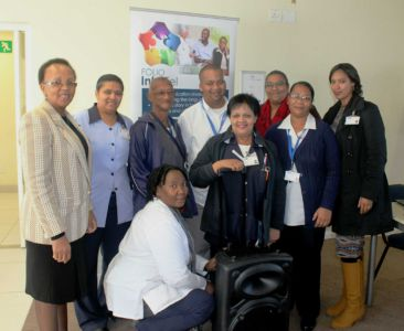 Staff members of Mitchells Plain CHC, two-time winner of Folio InterTel's monthly competition, with their prize, a portable PA system with cordless microphones. 23.06 16.