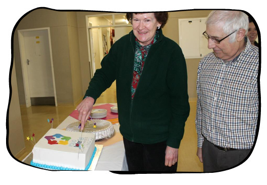 The honour of cutting the winner's cake went to two TC Newman CDC staff members, each boasting 40 years' loyal service.